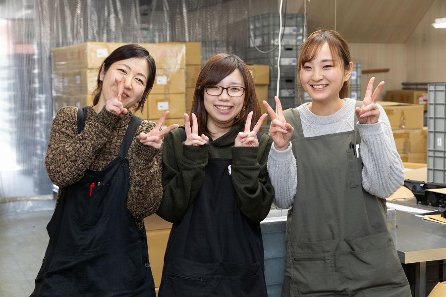 女性スタッフの笑顔